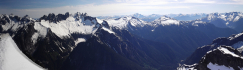 Amazing near-360 degree summit panorama from Slesse at extreme left to Mount Baker at right.