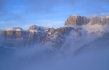 The clouds break to reveal the Sella Massif after a light snowfall