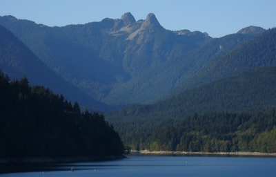 The Lions as seen from Capilano Lake at Cleveland Dam (West Lion at left).