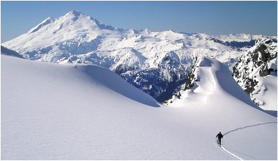 The NE side of Mount Baker as seen from high on Mount Shuksan. The latter potion of the traverse covers the high country visible just below the horizon at right.